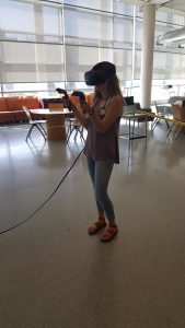 Photo of a student using virtual reality equipment